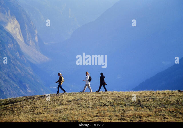 three women hiking above the alpine resort of Zermatt. Switzerland. Europe - Stock-Bilder