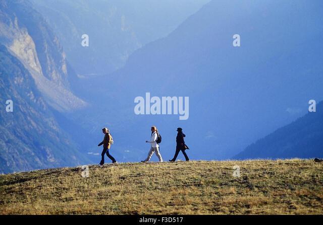 three women hiking above the alpine resort of Zermatt. Switzerland. Europe - Stock-Bilder