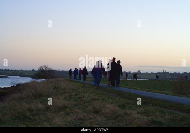 People Walking in late afternoon by River Deben Woodbridge Suffolk England - Stock Image