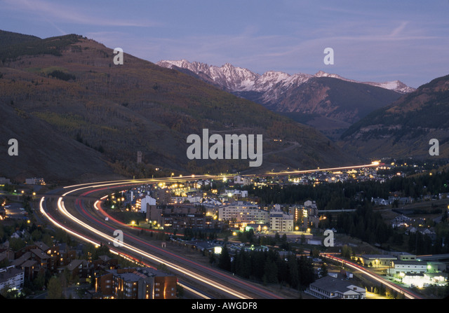 Colorado The West Rocky Mountain State Vail dusk Interstate 70 traffic snow capped Gore Range - Stock Image