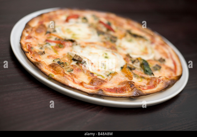 Goats cheese and roasted vegetable pizza - Stock Image