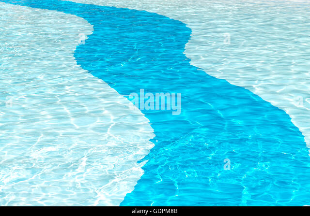clear crystal cool swimming pool background with sun reflection ripples in a two tone blue solid curve patten, ideal - Stock Image