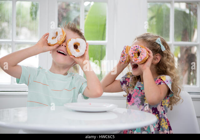 kids play with food - Stock Image