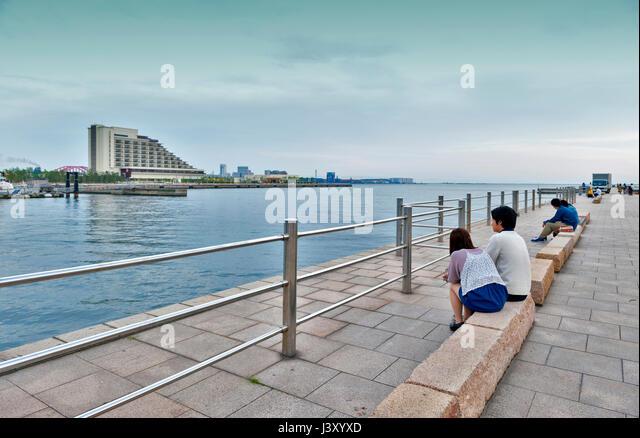 Kobe, Japan - April 2016: People relaxing at Kobe Port waterfront - Stock Image