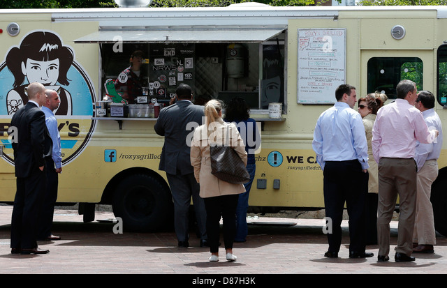 Office workers on lunch break at food truck in downtown Boston Massachusetts - Stock Image
