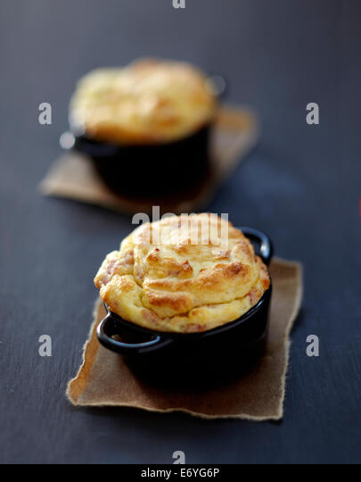 Potato and diced bacon soufflée - Stock Image