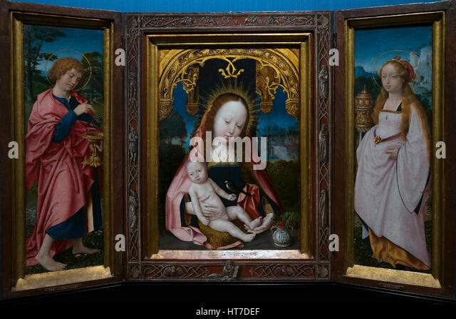 Triptych with Virgin and Child, John the Evangelist and Mary Magdalene, by Jan Provoost, circa 1520-5, Royal Art - Stock Image