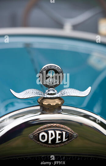 Detail of the hood ornament a classic Opel car - Stock Image