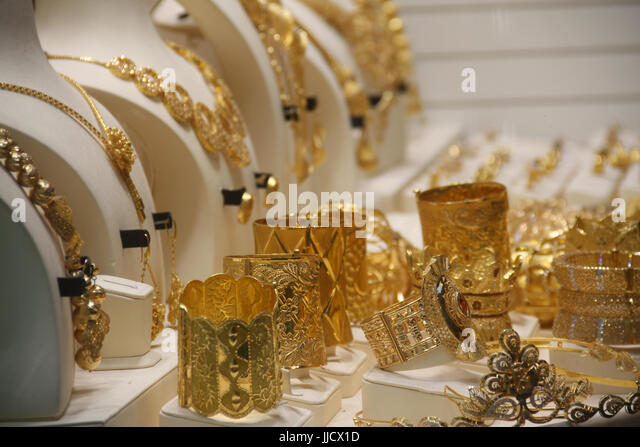 Precious ornaments made in real gold in different designs and patterns - Stock Image