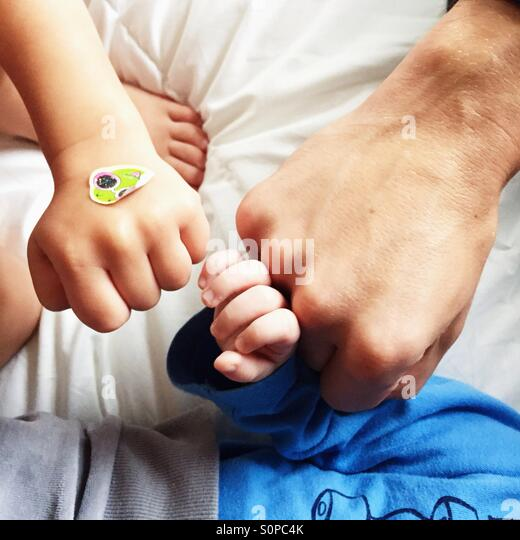 3 fists of father and two sons - family power - Stock Image