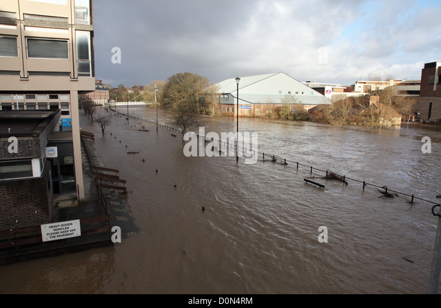 River Wear overflows and floods road within  Durham City adjacent to the National Savings and Investments building - Stock Image