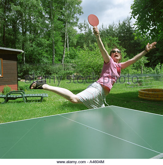 Woman playing ping-pong - Stock Image