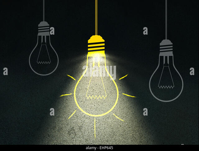 Drawing light bulb on cement wall - Stock Image