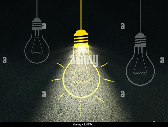 Drawing light bulb on cement wall - Stock-Bilder