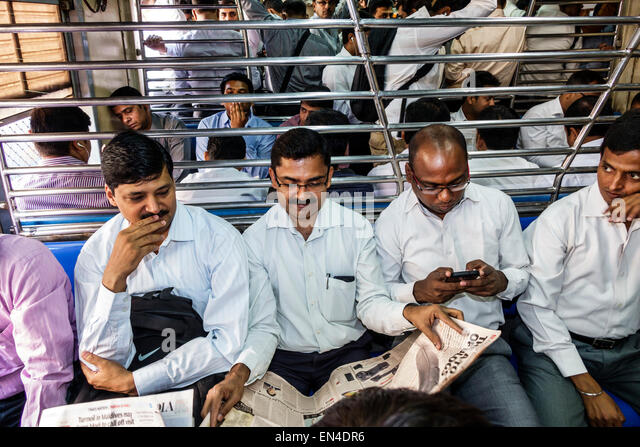 India Mumbai Asian Andheri Railway Station Western Line public transportation train commuters riders passengers - Stock Image