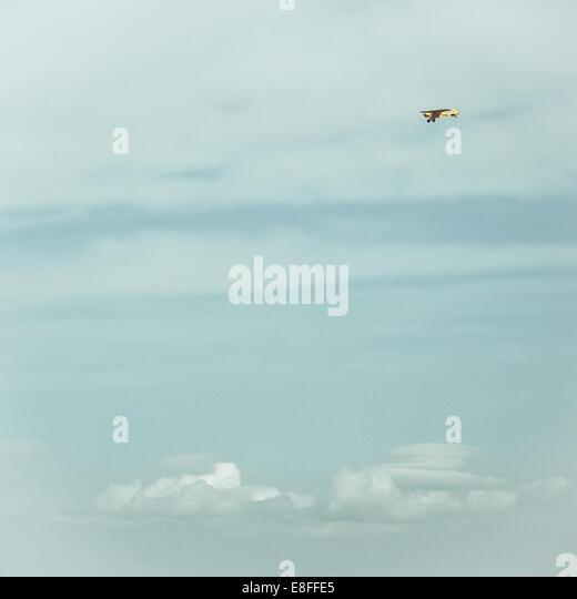 Plane in sky - Stock Image