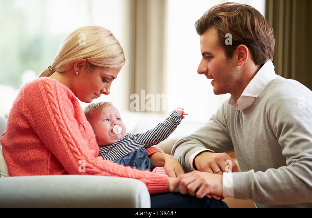 Couple With Woman Suffering From Post Natal Depression - Stock Image