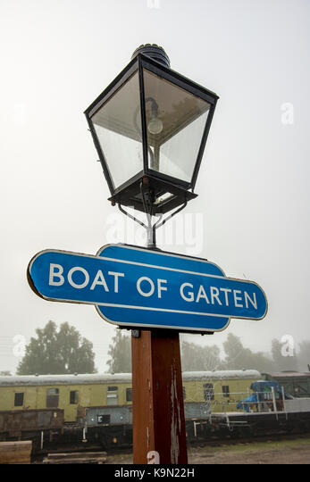 Lamp and sign at Boat of Garten station in Scotland, UK - Stock Image
