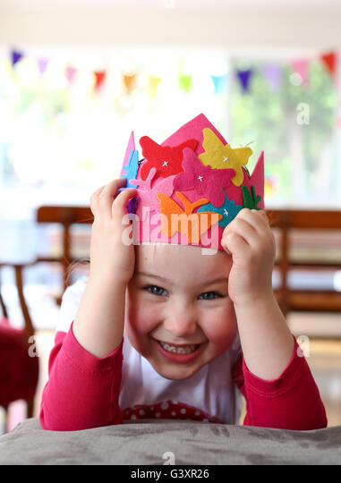 Child with party hat being silly - Stock Image