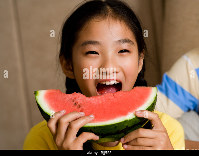 Closeup of girl eating watermelon - Stock Image