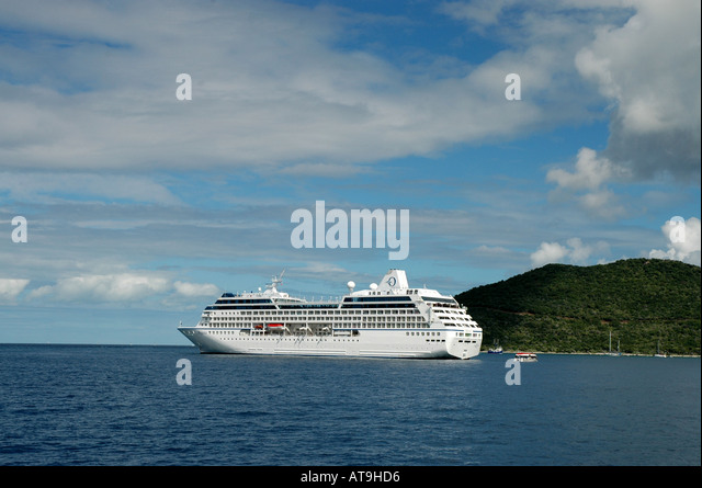 British Virgin Islands Virgin Gorda cruise ship with island in background - Stock Image
