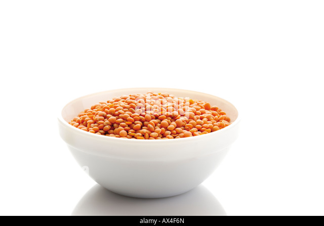 Red lentils in bowl - Stock Image