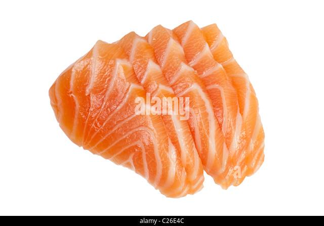 Slices of raw salmon used in sashimi isolated on white background - Stock Image