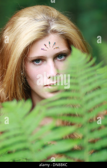 Woman with rhinestones on her forehead, portrait - Stock Image
