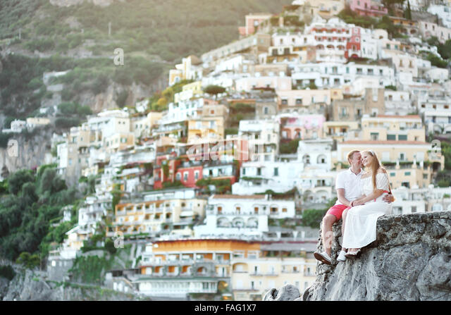young happy couple tenderly together in honeymoon in Positano, Amalfi coast, Italy - Stock Image