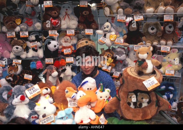 Moscow Russia Salesgirl with Stuffed Animals GUM Department Store - Stock Image
