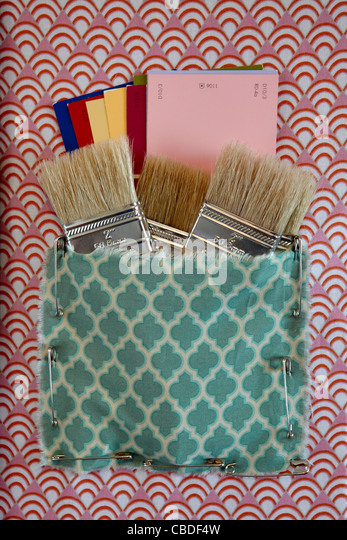 Craft supplies, paint brushes, color samples - Stock Image