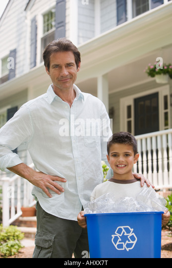Father and son with recycling bin - Stock Image