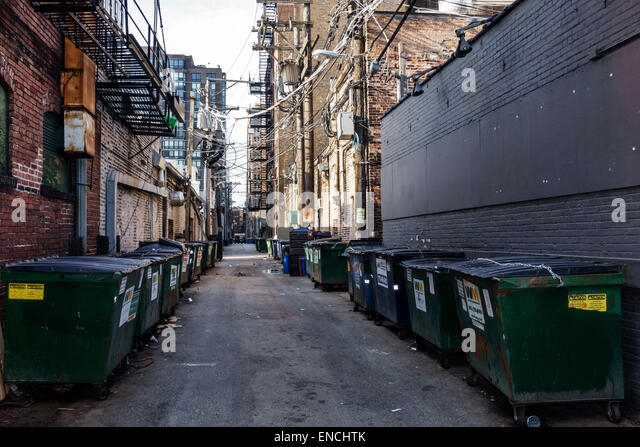 Chicago Illinois Near North Side neighborhood urban street scene alley alleyway back alley service road dumpster - Stock Image