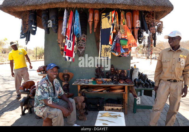 African roadside craft stall and stallholders, Zimbabwe, Africa - Stock Image