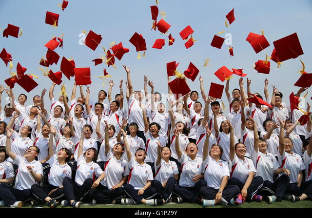 Botou, China's Hebei Province. 18th May, 2016. Student throw adult hats into the sky at a coming-of-age ceremony - Stock Image