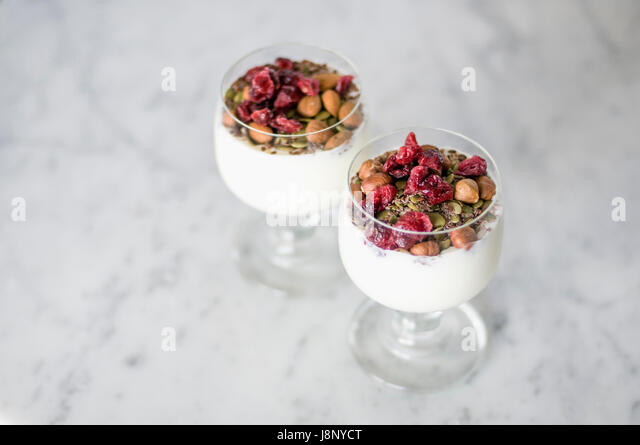 Desserts in glasses on table - Stock-Bilder