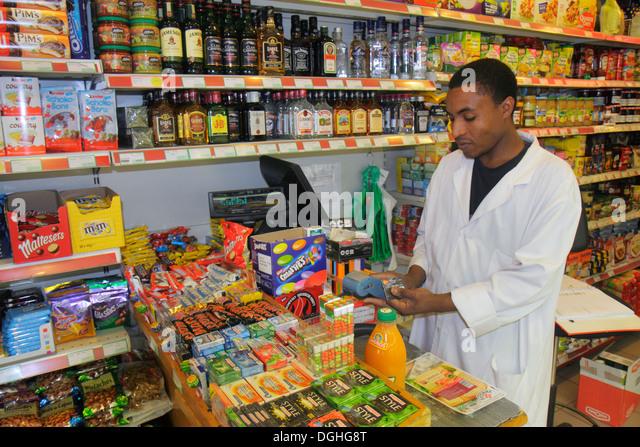 Paris France Europe French 16th 17th arrondissement Avenue de la Grande Armée Black North African man grocer - Stock Image