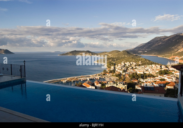 View over Kas from balcony with swimming pool in Western Turkey - Stock Image