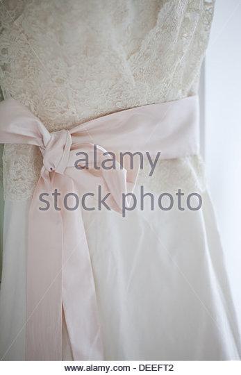 Bow on wedding dress - Stock Image