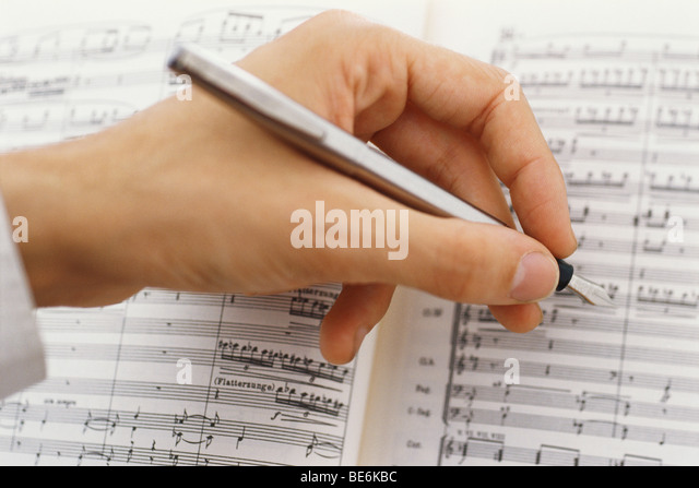Composer editing musical score - Stock Image