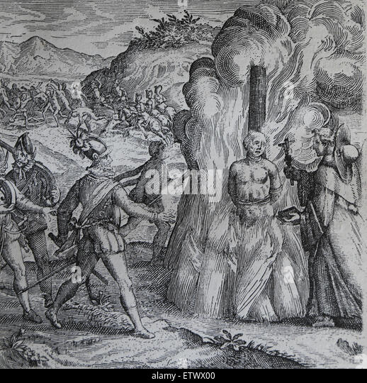 Bartolome de las Casas, Destruction of the Indies. Taino chief Hatuey being burnt by Spanish soldiers. - Stock Image