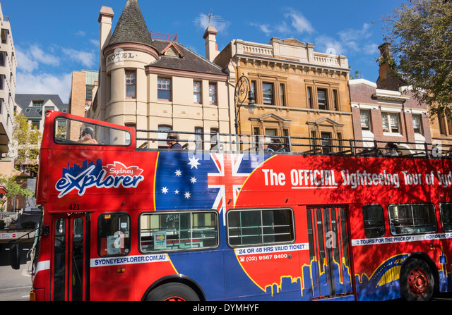 Sydney Australia NSW New South Wales The Rocks George Street historic district buildings double decker bus coach - Stock Image