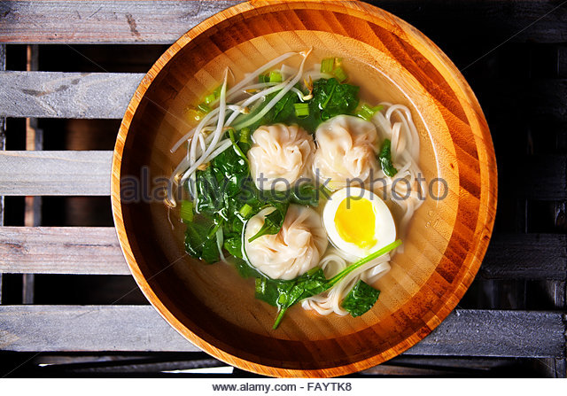 Shrimp and pork dumplings with spinach and eggs - Stock Image