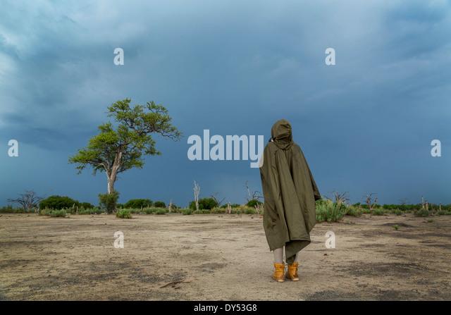 Woman photographing storm clouds, Kasane, Chobe National Park, Botswana, Africa - Stock Image