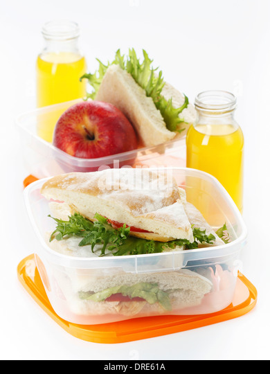 Lunch box with sandwich apple and juice - Stock-Bilder