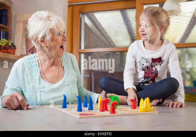 Girl playing board game with her grandmother, Bavaria, Germany - Stock-Bilder