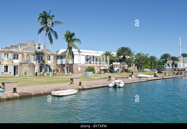 Nelsons Dockyard seen from the water showing historic buildings - Stock Image