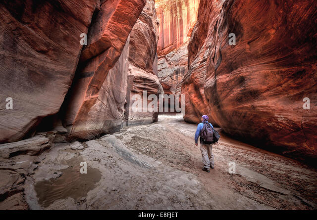 USA, Utah, Paria Canyon-Vermilion Cliffs Wilderness, Person Hiking in Buckskin Gulch - Stock Image
