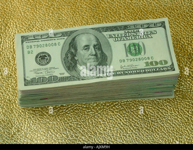 Still Life of a Stack of USA One Hundred Dollar $100 Bills on a Gold Background Viewed from Above with Copy Space - Stock Image