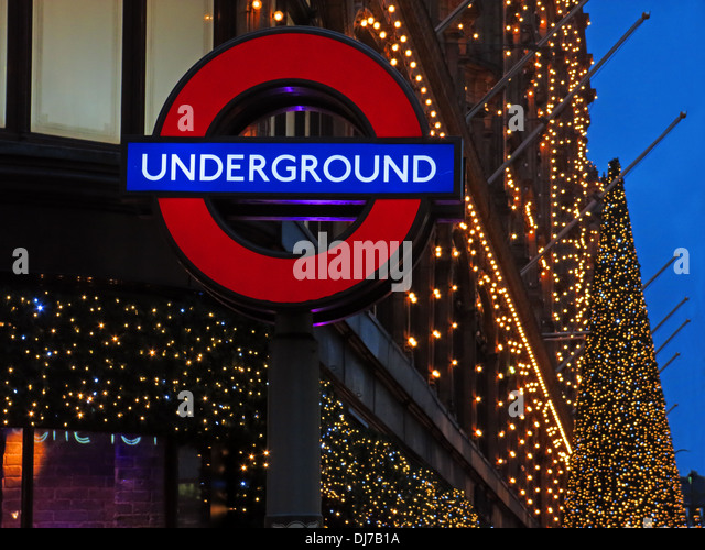 London Underground sign at Harrods Knightsbridge Brompton road , West London , England , UK at dusk - Stock Image